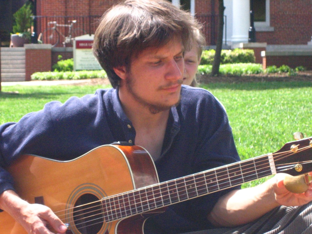 Jon Watts playing guitar on the Guilford College Quad